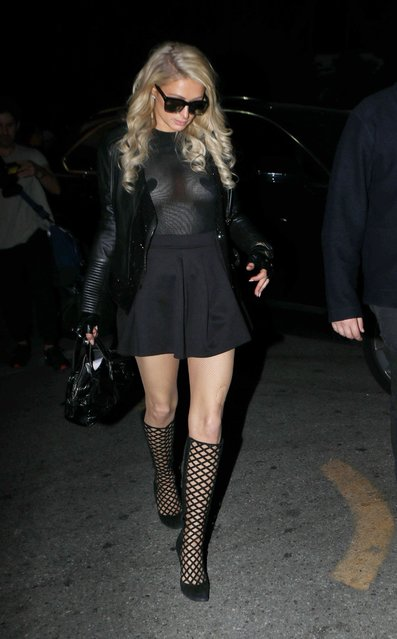 Paris Hilton is feeling super s*xy in all black as the world famous socialite turned DJ stuns in her sheer black top and short mini-skirt Saturday, November 9, 2019 in West Hollywood. The 38-year-old shows off her incredible frame while rocking knee high boots and torn fishnets at Logan Paul's post-fight party at Hyde. (Photo by X17/SIPA Press)