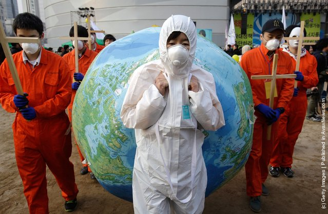 South Korean environmentalists participates in a rally held to commemorate the Fukushima nuclear disaster on the eve of the one year anniversary of Japan's earthquake and tsunami