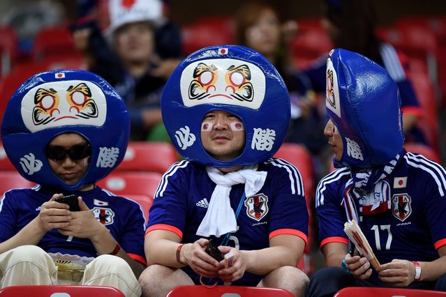 Japanese supporters wait for the start of the Group C football match between Ivory Coast and Japan at the Pernambuco Arena in Recife during the 2014 FIFA World Cup on June 14, 2014. (Photo by Toshifumi Kitamura/AFP Photo)