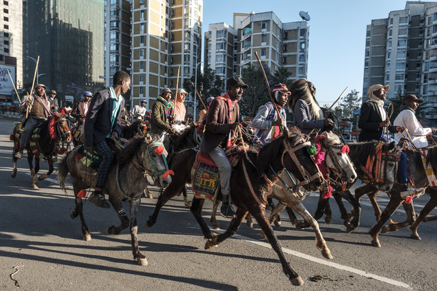Horsemen head to the airport as they prepare to welcome Ethiopian Prime Minister Abiy Ahmed on his return from the Peace Nobel Prize ceremony, in Addis Ababa, on December 12, 2019. Ethiopian Prime Minister Abiy Ahmed returned to Ethiopia on December 12, 2019, after receiving the Nobel Peace Prize at a ceromony in Oslo, Norway on December 10, 2019. (Photo by Eduardo Soteras/AFP Photo)