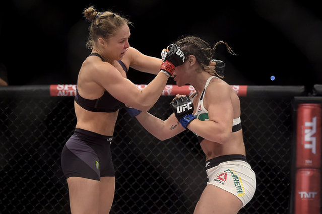In this photo released by Inovafoto, Ronda Rousey, left, of the United States, battles Brazil's Bethe Correia during their mixed martial arts bantamweight title fight at UFC 190, early Sunday, August 2, 2015, in Rio de Janeiro, Brazil. (Photo by Alexandre Loureiro/Inovafoto via AP Photo)