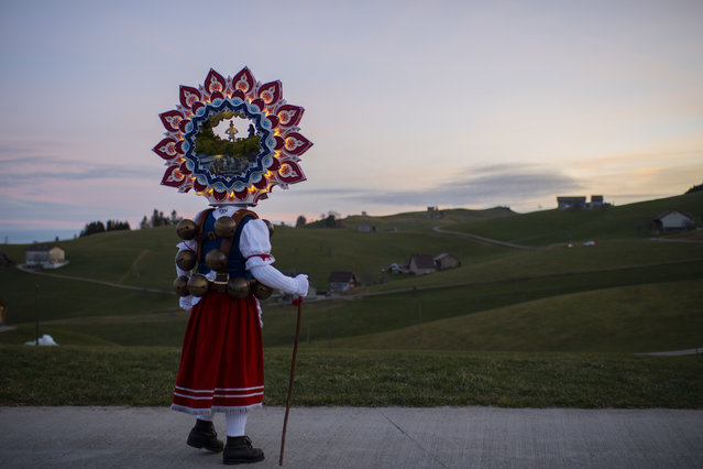"""A so-called """"Silvesterchlaus"""" (New Years Claus) of the group """"Hoernli-Schuppel"""" is on the way in Hundwil, Switzerland, Monday, January 13, 2020, to offer best wishes for the New Year (following the Julian calendar) to the farmers in this region. After their performance of singing and dancing the Silvesterchlaeuse receive hot drinks. (Photo by Gian Ehrenzeller/Keystone via AP Photo)"""