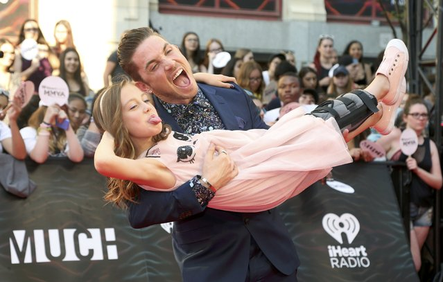 Dancer Blake McGrath and Livi arrive for the iHeartRadio Much Music Video Awards (MMVAs) in Toronto, Ontario, Canada June 19, 2016. (Photo by Peter Power/Reuters)