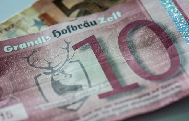 A picture made available on 17 July 2015 of a counterfeit banknote vaguely resembling a 10 euro note, which a pub owner indeed accepted, as counterfeit banknotes are presented at the German federal bank Bundesbank in Frankfurt Main, Germany, 15 July 2015.  Some 450,000 counterfeit euro banknotes were seized worldwide in the first half of 2015, acording to the European Central Bank (ECB). (Photo by Boris Roessler/EPA)