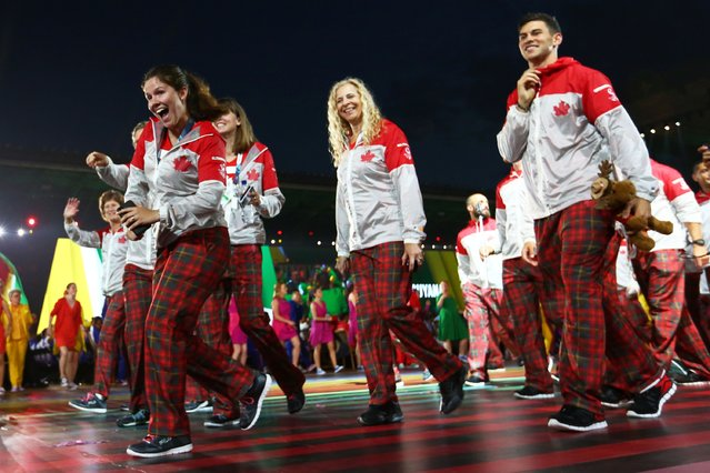 Canadian athletes arrive during the Opening Ceremony for the Glasgow 2014 Commonwealth Games at Celtic Park on July 23, 2014 in Glasgow, Scotland. (Photo by Quinn Rooney/Getty Images)
