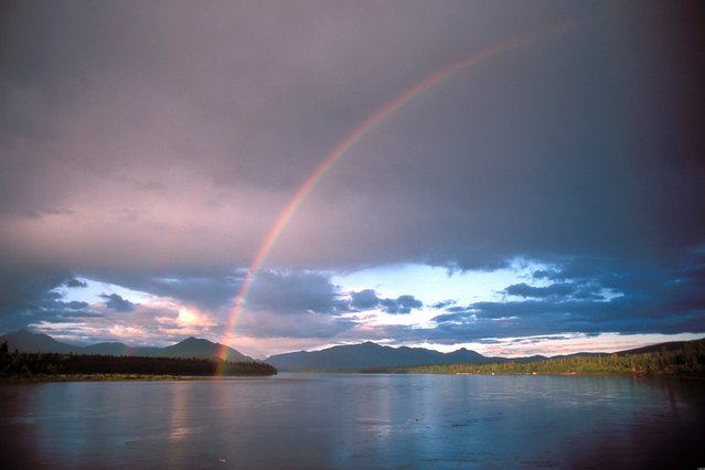 A rainbow is seen over the Yukon River in Eagle, Alaska in this undated handout photo courtesy of the U.S. Geological Society. (Photo by Reuters)