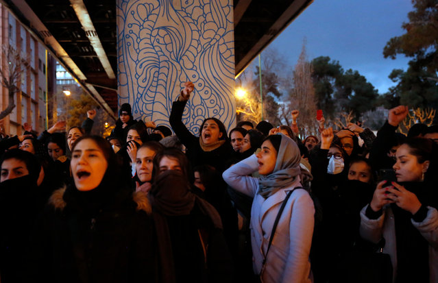 """Iranians protest to show their sympathy to victims of Ukraine International Airlines Boeing 737-800 in front of the Amir Kabir University in Tehran, Iran, 11 January 2020. The Iranian military released a statement on 11 January 2020 that Ukraine International Airlines flight PS752 was shot down due to """"human error"""". The passemger jet en route from Tehran to Kiev crashed minutes after takeoff on 08 January 2020, all all 167 passengers and nine crew members aboard were killed. (Photo by Abedin Taherkenareh/EPA/EFE)"""