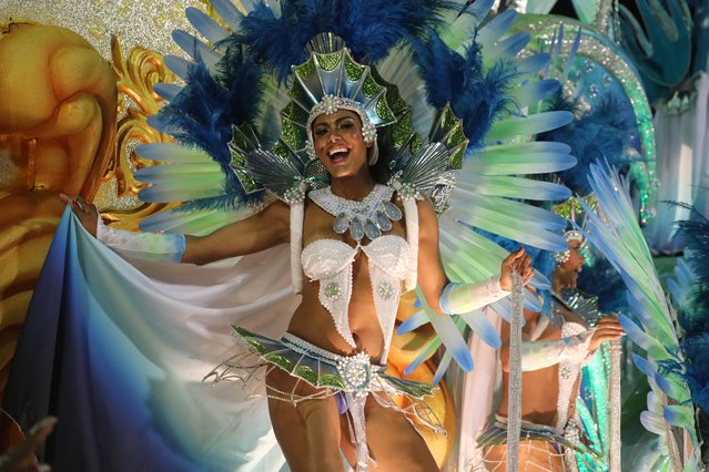 A Beija-Flor samba school member performs during the second night of the Carnival parade at the Sambadrome in Rio de Janeiro, Brazil on February 25, 2020. (Photo by Sergio Moraes/Reuters)