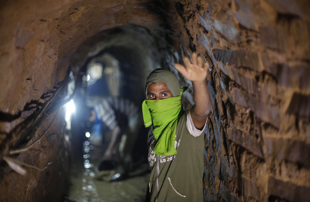 A Palestinian tunnel worker gestures as he repairs a smuggling tunnel flooded by Egyptian security forces, beneath the Gaza-Egypt border in the southern Gaza Strip September 10, 2013. (Photo by Ibraheem Abu Mustafa/Reuters)