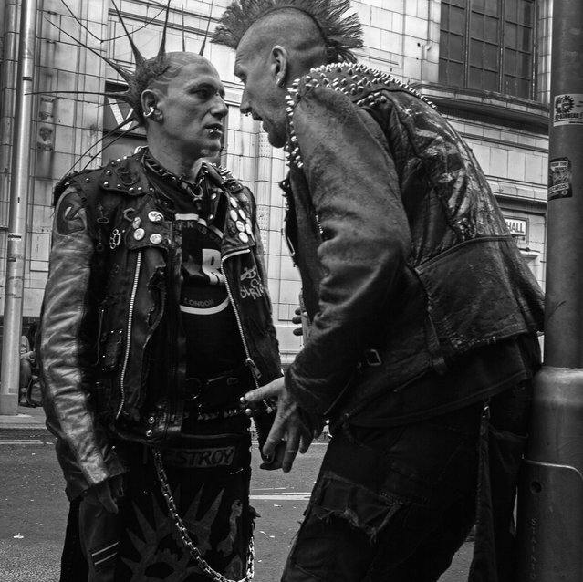 Punks talking as they prepare for the annual Rebellion Punk Rock Festival in Blackpool. (Photo by Christopher Furlong/Getty Images)