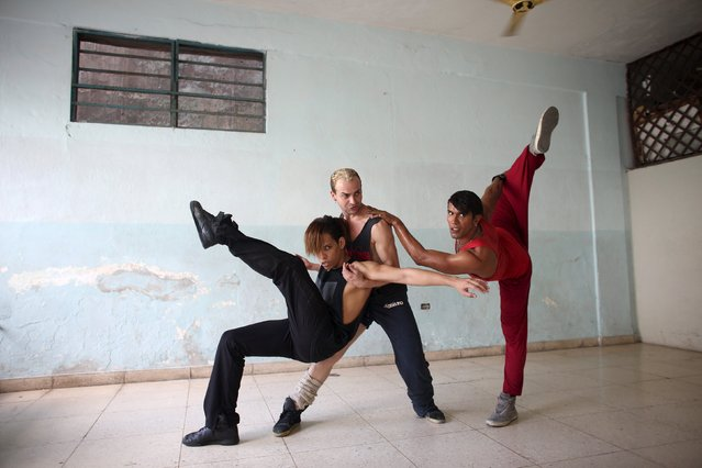 "Dancers for TV shows, (L-R) Yasel Rodriguez, 26, Yudisvani Rabi, 32 and Maykel Puentes, 30, dance during a contemporary dance training session as part of ""Proyecto Divino"" (""Devine Project"" in Spanish), in downtown Havana, February 4, 2015. (Photo by Alexandre Meneghini/Reuters)"