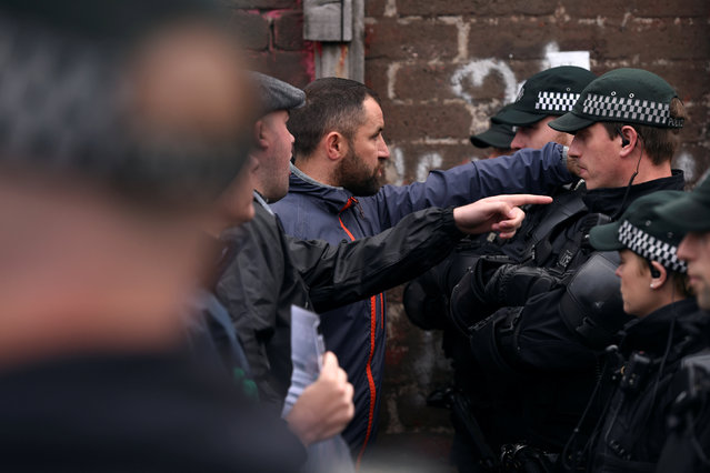 Members of the Greater Ardoyne Residents Coalition GARC are seen in a stand off with Police as they wait for the Twelfth of July Orange Order March to come down the Crumlin Road in Belfast, Northern Ireland, July 12, 2016. (Photo by Clodagh Kilcoyne/Reuters)