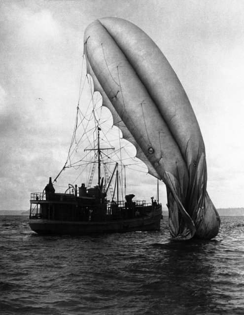This barrage balloon which broke from its moorings and came down in water (some where in the Pacific Northwest) is being retrieved by a patrol boat  August 27, 1942. Army authorities said the balloon suffered only minor damage. (Photo by AP Photo)