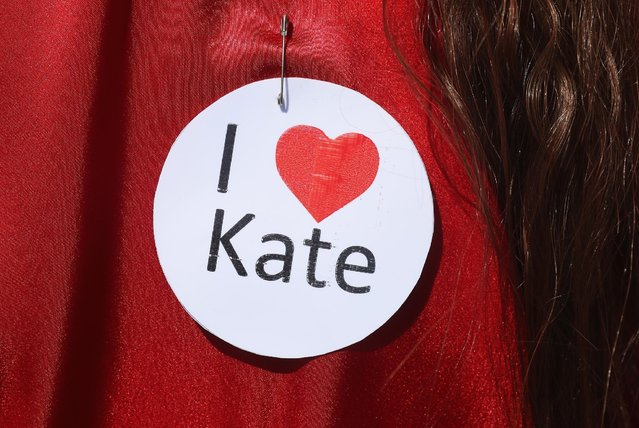 """A participant dressed as singer Kate Bush from her 1978 video to her song """"Wuthering Heights"""" wears an """"I love Kate"""" pin prior to attempting to create a new world's record for the most people dancing in costume to the song at once at Tempelhofer Feld park on July 16, 2016 in Berlin, Germany. (Photo by Sean Gallup/Getty Images)"""