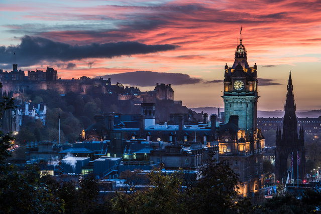 Beautiful red sunset sky over Edinburgh, Scotland. Edinburgh is the capital city of Scotland and a popular tourist destination. It is also a major European financial (fund management) centre. Prominent buildings from left to right are: Edinburgh Castle, The Balmoral Hotel Clock Tower and The Scott Monument. (Photo by John Lawson/Getty Images)