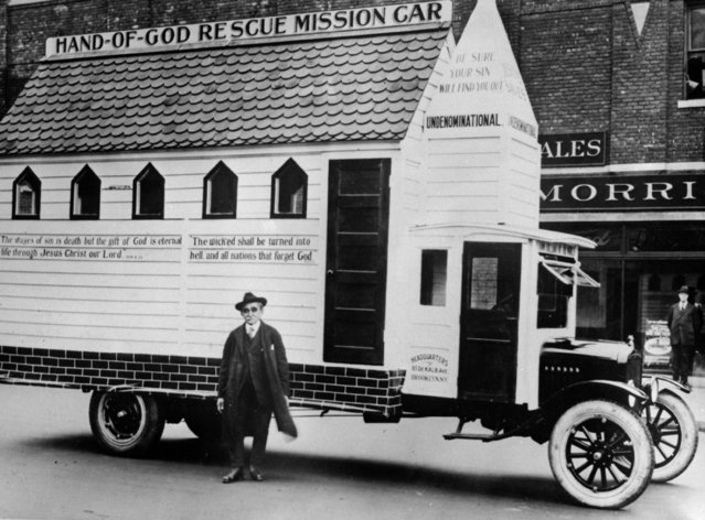 Herman Frics, one-time saloonkeeper and now evangelist and principal supporter of the Hand Of God Mission of Brooklyn, New York, with the church on wheels, which he takes into the city's slums to preach, circa 1925.