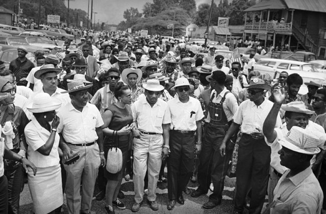 In this Sunday, June 26, 1966 file photo, thousands of civil rights marchers assemble for the last leg of the Mississippi March from Tougaloo College north of Jackson, Miss., to the Capitol. In the front row, from left are the Rev. Ralph Abernathy, Juanita Abernathy, Mrs. Coretta Scott King, Dr. Martin Luther King, James Meredith, Stokely Carmichael of the Student Non-Violent Coordinating Committee (looking back) and Floyd B. McKissick, national director of the Congress of Racial Equality. (Photo by Charles Kelly/AP Photo)