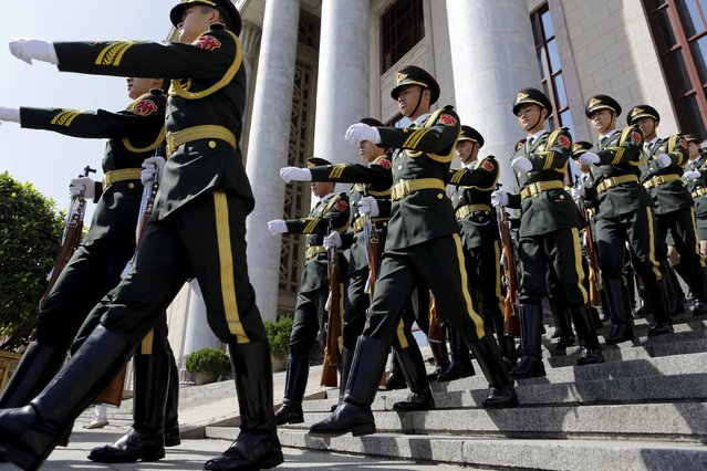 Soldiers from the honor guards leave the Great Hall of the People after a medal ceremony marking the 70th anniversary of the Victory of Chinese People's War of Resistance Against Japanese Aggression, for World War Two veterans, in Beijing, China September 2, 2015. (Photo by Jason Lee/Reuters)