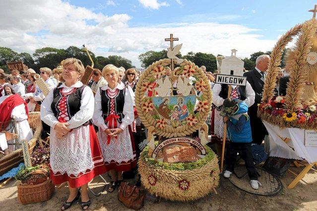 People attend holy mass during a harvest festival at Jasna Gora in Czestochowa, Poland, September 6, 2015. (Photo by Grzegorz Skowronek/Reuters/Agencja Gazeta)