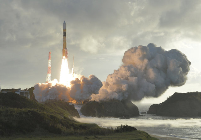An H-2A rocket carrying Japan's fourth and final quasi-zenith satellite, the Michibiki No. 4, lifts off from the Tanegashima Space Center in Kagoshima Prefecture, southwestern Japan in this photo taken by Kyodo on October 10, 2017. (Photo by Reuters/Kyodo News)