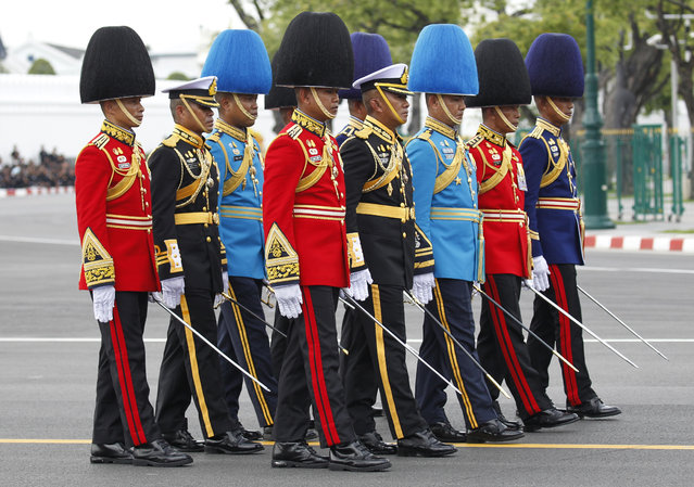 The royal honor guard walk in the funeral procession and royal cremation ceremony of late Thai King Bhumibol Adulyadej, in Bangkok, Thailand, Thursday, October 26, 2017. (Photo by Sakchai Lalit/AP Photo)