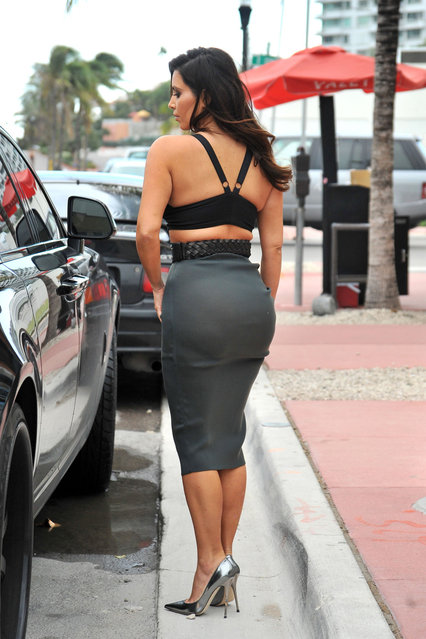 Sunday October 14, 2012. Kim Kardashian looks to have left her underwear at home as she heads out for an early dinner with boyfriend Kanye West in Miami. As Kim checked out her outfit in the reflection of her car, it became apparent that the reality star was not wearing any underwear as she showed off her see-through grey skirt. (Photo by Brett Kaffee/Thibault Monnier/PacificCoastNews.com)
