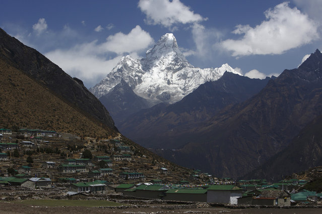 Mount Ama Dablam, which stands approximately 22310 feet above sea level, is seen behind Khumjung Village in Solukhumbu District April 30, 2014. (Photo by Navesh Chitrakar/Reuters)