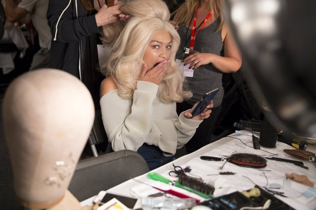 Model Gigi Hadid yawns as she is prepared backstage before the Jeremy Scott Spring/Summer 2016 collection presentation during New York Fashion Week in New York, September 14, 2015. (Photo by Andrew Kelly/Reuters)