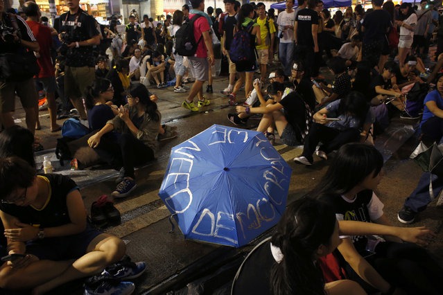 Protesters rally next to an umbrella as they block the main road at Causeway Bay shopping district in Hong Kong September 30, 2014. (Photo by Bobby Yip/Reuters)