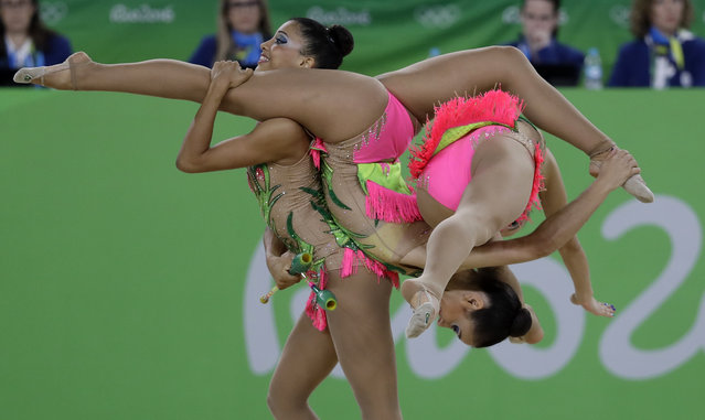 Team Brazil performs during the rhythmic gymnastics group all-around qualifications at the 2016 Summer Olympics in Rio de Janeiro, Brazil, Saturday, August 20, 2016. (Photo by Rebecca Blackwell/AP Photo)