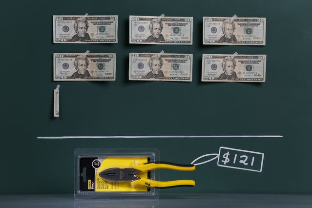 A pair of Stanley brand household pliers as photographed in a studio with an illustrative price tag of $121 (US dollars), equivalent to the Bs. 765 (bolivars) that it costs on average to purchase in Caracas at the official exchange rate of 6.3 bolivars per dollar, in Caracas September 29, 2014. (Photo by Carlos Garcia Rawlins/Reuters)