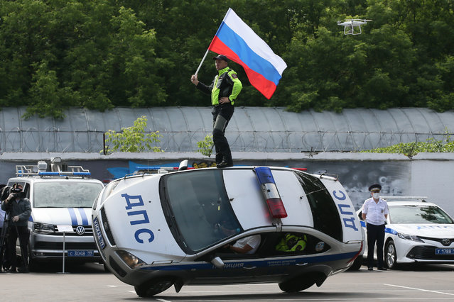 Members of the Kaskad (Cascade) stunt team perform in Moscow, Russia on July 3, 2020 on the parade ground of the 2nd Separate Special Purpose Battalion of the Road Patrol Service under the General Traffic Safety Administration (GIBDD) on Traffic Police Day annually celebrated on July 3 in Russia. (Photo by Vladimir Gerdo/TASS)