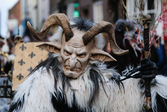 Participants take part in the Whitby Krampus parade on December 2, 2017 in Whitby, England. The Krampus is a horned, anthropomorphic figure from Austro-Bavarian Alpine folklore who during the Christmas season punished children who had misbehaved. The event held in Whitby helps to raise money for the Whitby Wildlife Sanctuary charity. (Photo by Ian Forsyth/Getty Images)