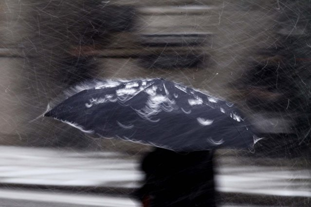 A person crosses Broad Street during a snow storm, December 26, 2010, in Philadelphia. (Photo by Matt Slocum/Associated Press)