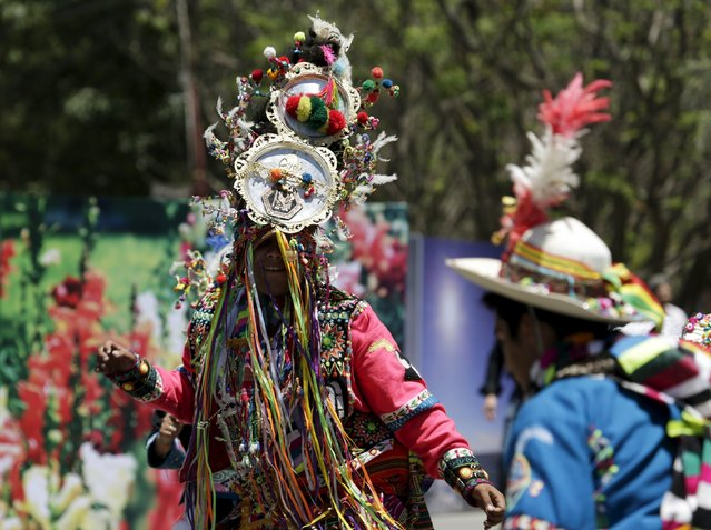 Dancers of Thinku group perform at the World People's Conference on Climate Change and the Defense of Life, prior to the World Climate Change Conference, in Tiquipaya, Bolivia, October 10, 2015. Almost 150 nations, including major emitters led by China and the United States, have submitted plans to the United Nations for curbing greenhouse gas emissions blamed by the U.N. for causing more floods, droughts and heat waves. (Photo by David Mercado/Reuters)