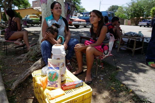 Women sell coffee and staple items in a street at Villa Rosa, near Porlamar, Venezuela September 16, 2016. (Photo by Marco Bello/Reuters)