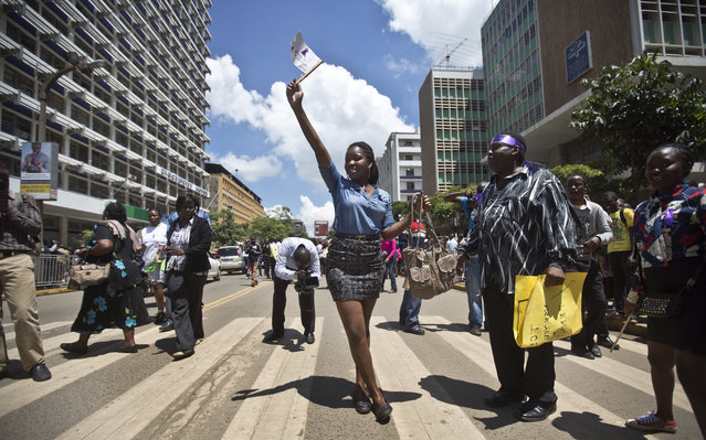 A Kenyan woman protests with others for the right to wear whichever clothes they want, at a demonstration in downtown Nairobi, Kenya Monday, November 17, 2014. (Photo by Ben Curtis/AP Photo)