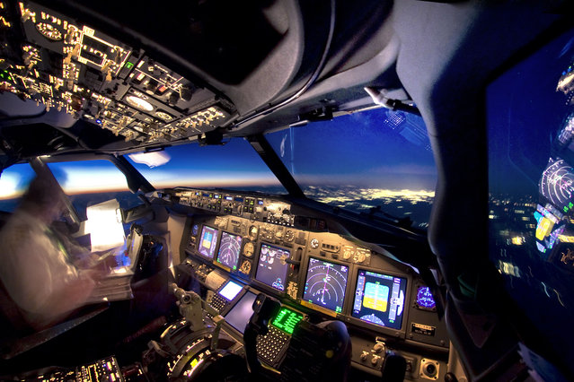 An amazing view of a lighted sky line from the cockpit. (Photo by Christiaan van Heijst/Daan Krans/Caters News Agency)