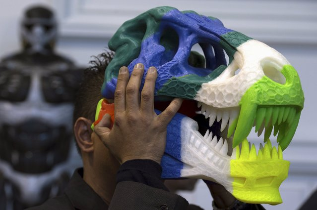 A 3D printing professional wears his T-Rex skull creation during a 3D printing show in Brussels, Belgium, October 18, 2015. (Photo by Eric Vidal/Reuters)