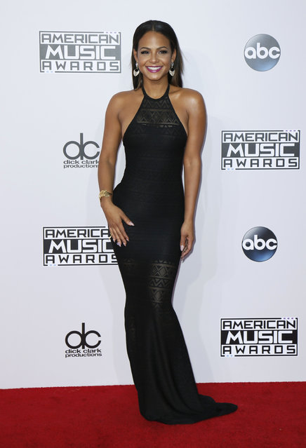 Actress Christina Milian arrives at the 42nd American Music Awards in Los Angeles. (Photo by Danny Moloshok/Reuters)