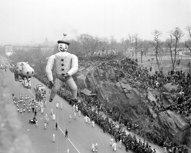 With a dopey clown and the kind of hippo you see only in a hangover, Macy's annual Thanksgiving Day parade trundles down Central Park West, 1940. (Photo by NY Daily News Archive via Getty Images)