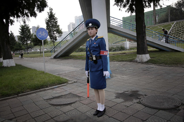 A North Korean traffic police woman monitors vehicles and pedestrians along a busy street corner on Tuesday, September 27, 2016, in Pyongyang, North Korea. (Photo by Wong Maye-E/AP Photo)