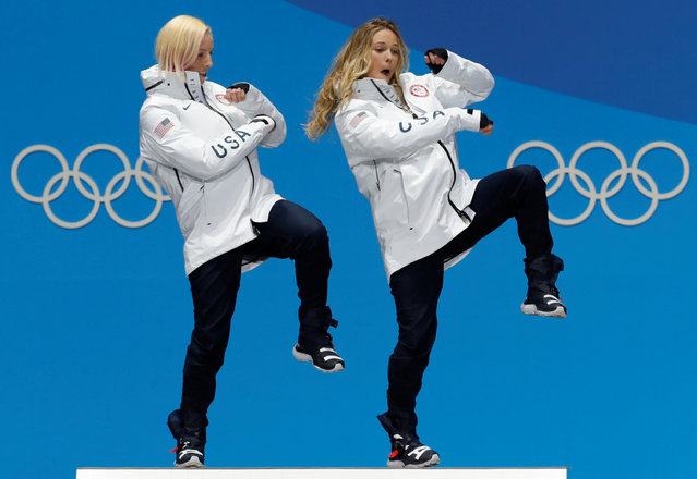 Gold medalists Kikkan Randall and Jessica Diggins of the United States dancing during the medal ceremony for Cross-Country Skiing – Ladies' Team Sprint Free on day 13 of the PyeongChang 2018 Winter Olympic Games at Medal Plaza on February 22, 2018 in Pyeongchang-gun, South Korea. (Photo by Eric Gaillard/Reuters)