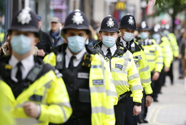 Metropolitan Police officers escort a protest against coronavirus (Covid-19) measures and vaccine despite social gatherings of more than six people are not be allowed within Covid-19 measures in London, United Kingdom on October 17, 2020. (Photo by London News Pictures/The Sun)