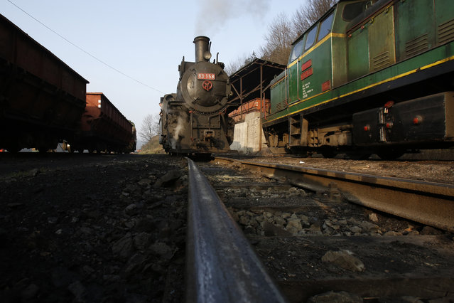 A steam engine arrives at a station inside the coal mine of Oskova in the Bosnian town of Banovici, 140 kms (86.9 miles) north of Sarajevo, on Monday, November 24, 2014. (Photo by Amel Emric/AP Photo)