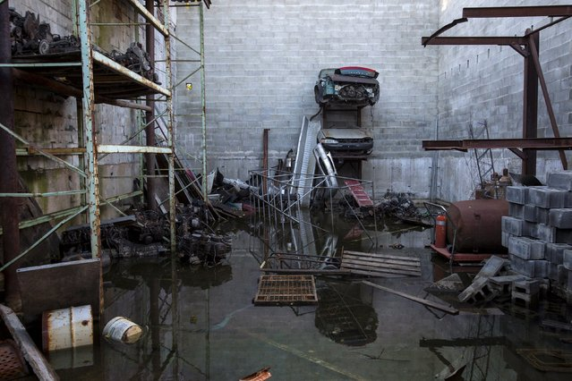 A vacated business stands flooded in the Willets Point area of Queens in New York October 30, 2015. (Photo by Andrew Kelly/Reuters)