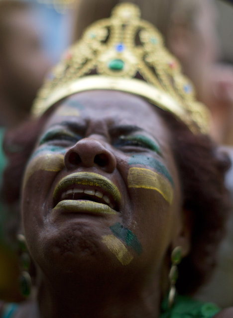 In this July 8, 2014 file photo, a Brazil soccer fan weeps as she watches Germany score repeatedly against Brazil at a World Cup semifinal match on a live telecast inside the FIFA Fan Fest area in Sao Paulo, Brazil. (Photo by Dario Lopez-Mills/AP Photo)