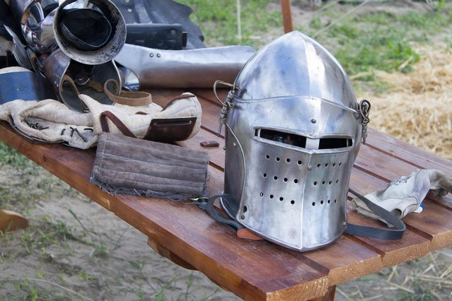"A helmet lays on a table during the ""Battle of Nations"" in Aigues-Mortes, southern France, Friday, May 10, 2013 where Middle Ages fans attend the historical medieval battle  competition. The championship will be attended by 22 national teams, which is twice the number it was last year. The battle lasts until May 12. (Photo by Philippe Farjon/AP Photo)"