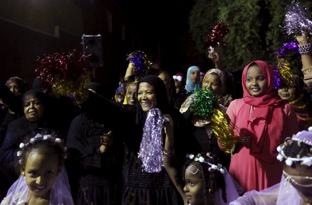 Nubian women celebrate at a traditional Nubian wedding in the Nubian village of Adindan near Aswan, south of Egypt, September 30, 2015. (Photo by Mohamed Abd El Ghany/Reuters)