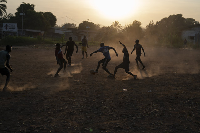 Youths play soccer during as the sun sets in Koidu, district of Kono, Sierra Leone, Tuesday, November 24, 2020.(Photo by Leo Correa/AP Photo)